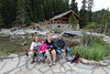 A tired family, with the Lake Agnes teahouse in the background.