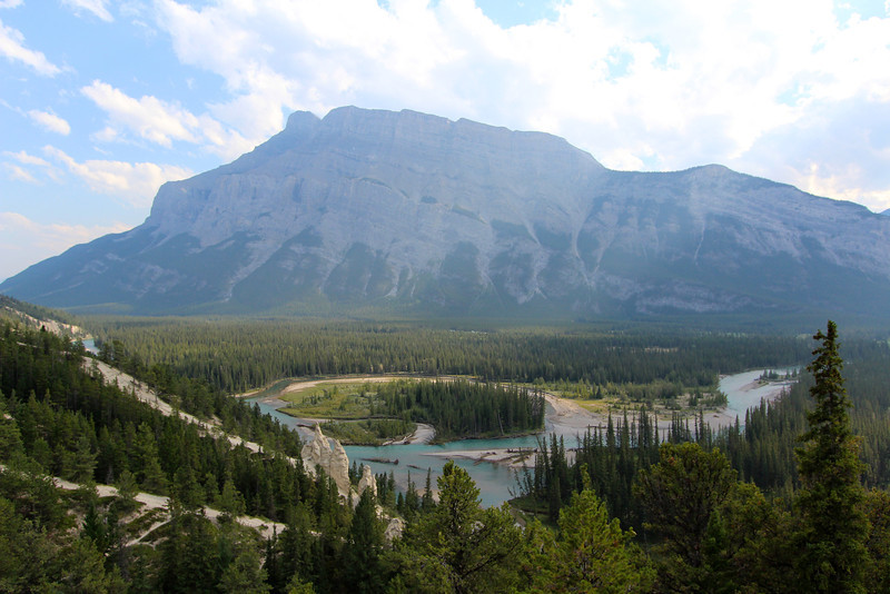A wide view of the Hoodoos, with Mount Rundle in the background.