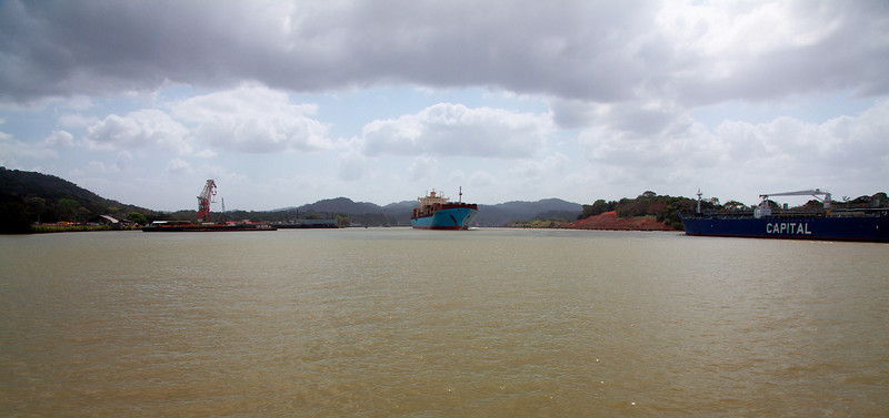 Arriving in Gamboa on a small boat, amidst huge ocean-going ships passing through the Panama canal.