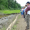 Project Manager Alex Hackman provides tours during the celebration of the successful removal of the Bartlett Pond Dam, on the Wekepeke Brook in Lancaster on Tuesday afternoon. <br /> SENTINEL & ENTERPRISE / Ashley Green