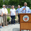 Lancaster Town Administrator Orlando Pacheco speaks during the celebration of the successful removal of the Bartlett Pond Dam, on the Wekepeke Brook in Lancaster on Tuesday afternoon. Behind Pacheco are Ken Rapoza, of the Conservation Committee, Selectman Stan Starr, Mary Griffin, the Commissioner of the Department of Fish & Game, Representative Hank Nauton, and Energy and Environmental Affairs Secretary Maeve Vallely Bartlett.<br /> SENTINEL & ENTERPRISE / Ashley Green