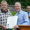 Representative Hank Naughton presents Ken Rapoza, of the Conservation Committee, with a citation from the Commonwealth of Massachusetts during the celebration of the successful removal of the Bartlett Pond Dam, on the Wekepeke Brook in Lancaster on Tuesday afternoon. <br /> SENTINEL & ENTERPRISE / Ashley Green