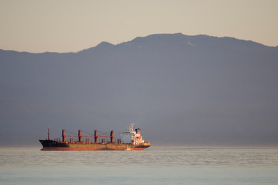 Evening sun on freighter - from Clover Point area, Victoria, B.C.