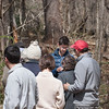 Tate Bushell of Pound Ridge Land Conservancy points out features of wildflowers on the trail
