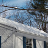 Snowdrifts on roof after blizzard