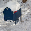 Mail box in plow drift after blizzard