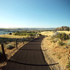 Starting at the Discovery Center, the river front trail features the Columbia River still scouring away at the basaltic basin of the eastern portal to The Gorge.  The unfinished eastern end of the trail reches nearly to The Dalles Dam.