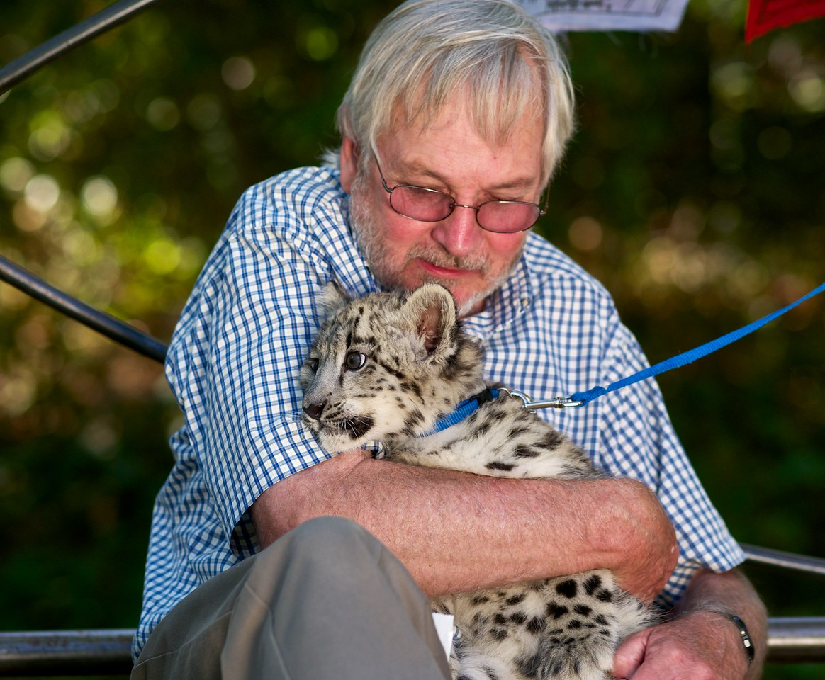 "Rodney Jackson of Snow Leopard Conservancy with baby snow leopard, ""Jackson""."