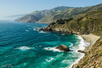 The rocky coastline hides hundreds of small beaches along the way.  In the distance is the Big Creek bridge, built in a similar fashion to the Bixby bridge, but with two spans.