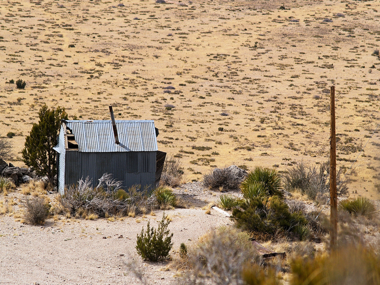 OLYMPUS DIGITAL CAMERA--Old mining shack, overlooking the desert floor, located high up on the mountain.