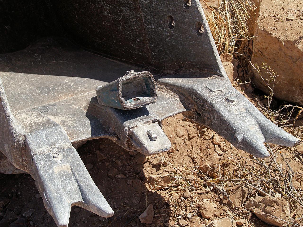 OLYMPUS DIGITAL CAMERA--Broken tooth on bucket of trackhoe.