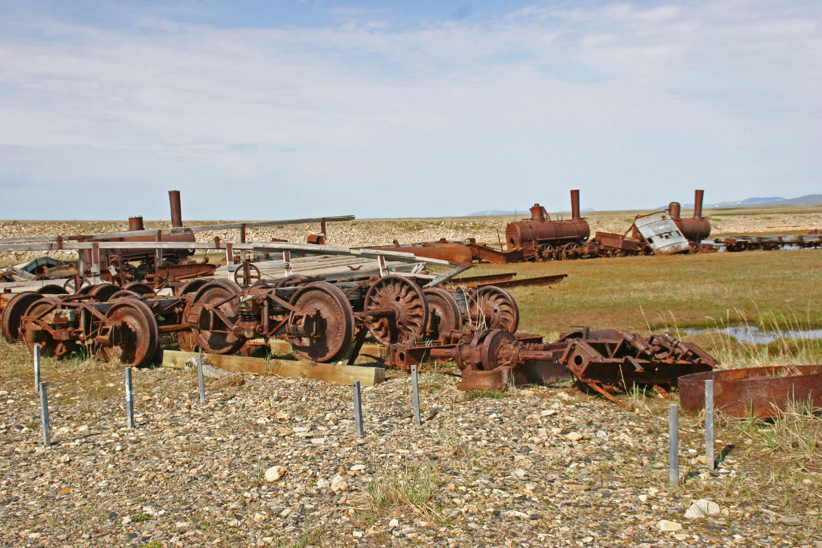 """""""Goldrush"""" Railroad to Nowhere - Nome.  The railroad was started to haul freight during the gold rush days.  The tracks were washed out by a storm before the railroad was completed and the equipment was stranded  and left to rust, where it sat, near the beach."""