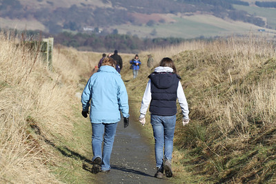 The girls walk between the bunds at Vane Farm