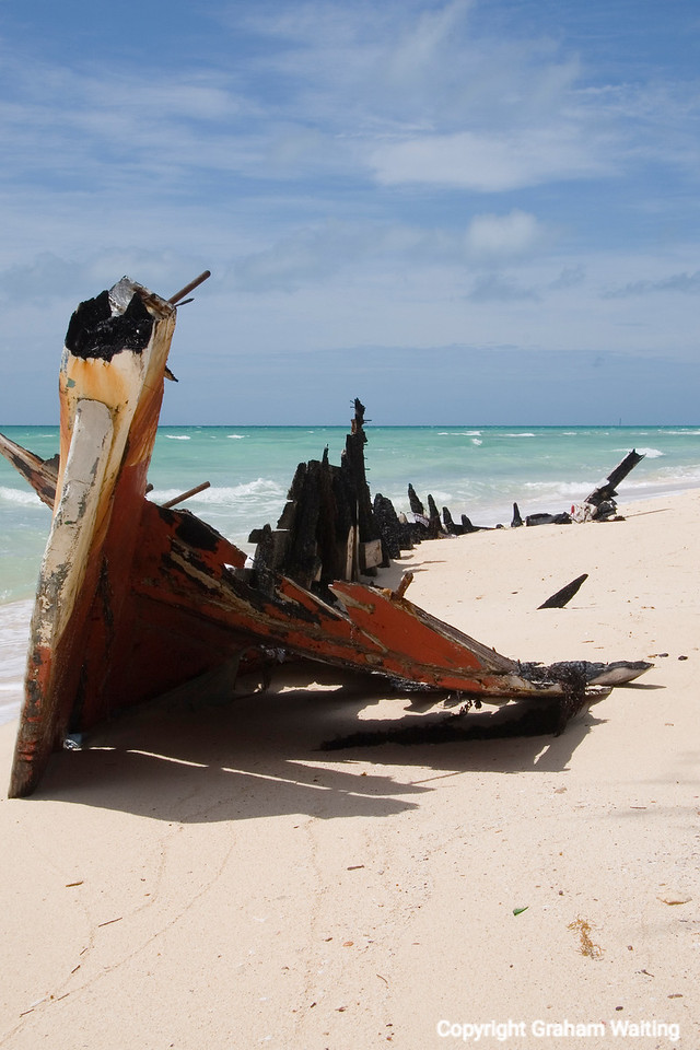 Burned out boat on beach in the Bahamas