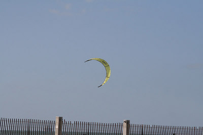 Although out of sight here, each of these kites had a surfer attached.