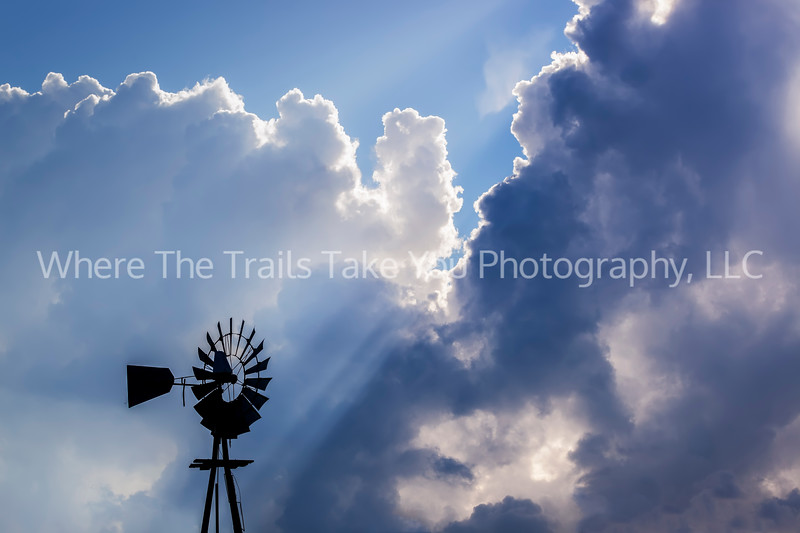 159  Dramatic Clouds, Sun Rays, and Windmill
