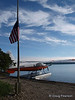 One of the float planes of Katmai Air. Taken in front of the Ranger station at Brooks Camp and Lodge in the Katmai National Park.  The flag was at half staff in memorial of a firefighter killed in the California wildfires of 2008.