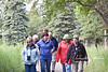 "Part of the group walking back from the Falls.  In order to avoid startling a bear, we were encouraged to periodically say (in a loud voice), ""Hey, bear!"" as we walked, especially when we were on the narrow trail through the woods (this is a service road near the bridge)."