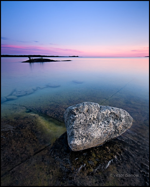 <h3>Myles Bay. Bruce Peninsula Ont.</h3> <h5>Canon40D, Sigma10-20 at 10mm, Lee0.9hard grad & Sing Ray LB polarizer,<br> 4s at f/11.0  </h5> My first visit to Myles Bay was on a beautiful summer day.  Somehow conditions were ideal in all respects.  Anyone who frequents this area knows this to be a very uncommon occurance.  I spent the evening scouting for possible future locations and after sunset took this shot.