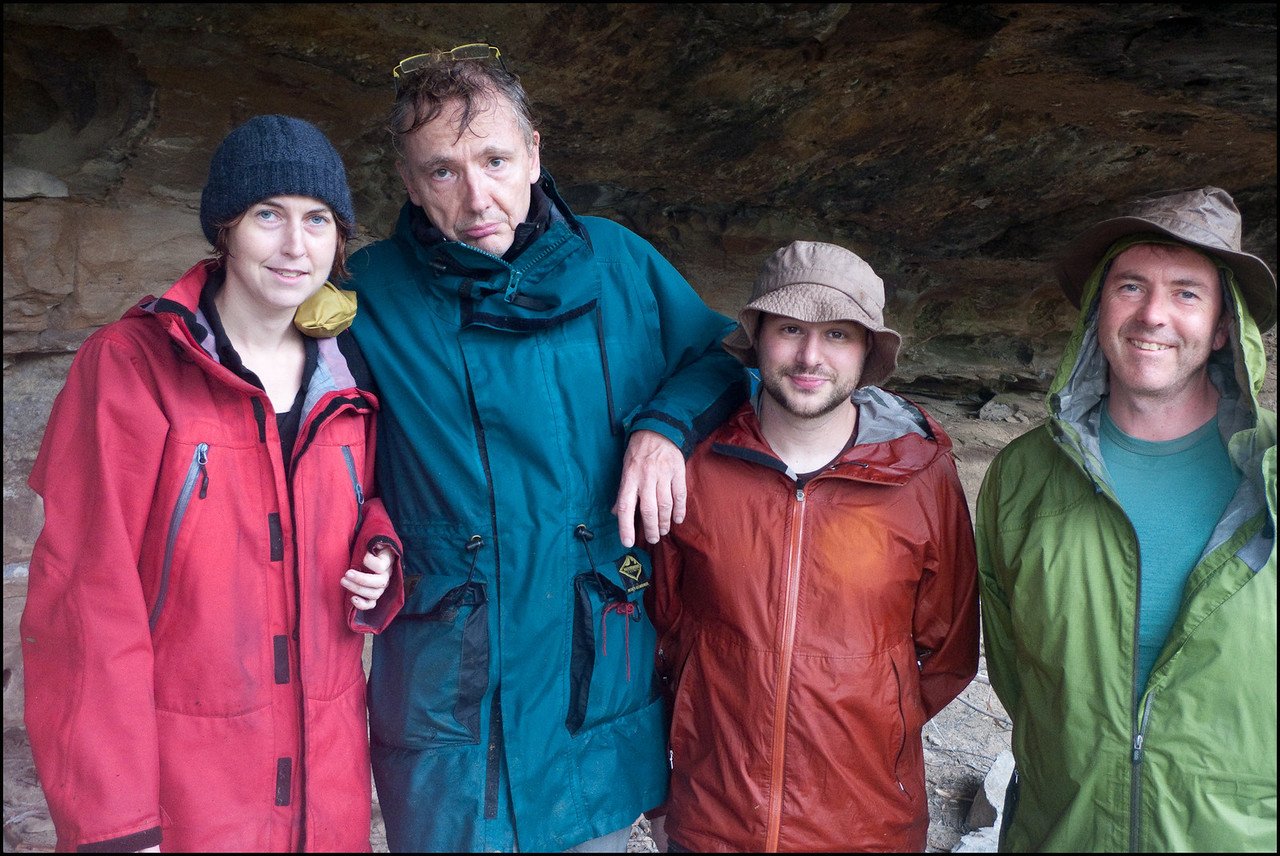 "After our arrival in the rain at the camping cave, Paul insists that a photo of the ""drowned rats"" be  taken."