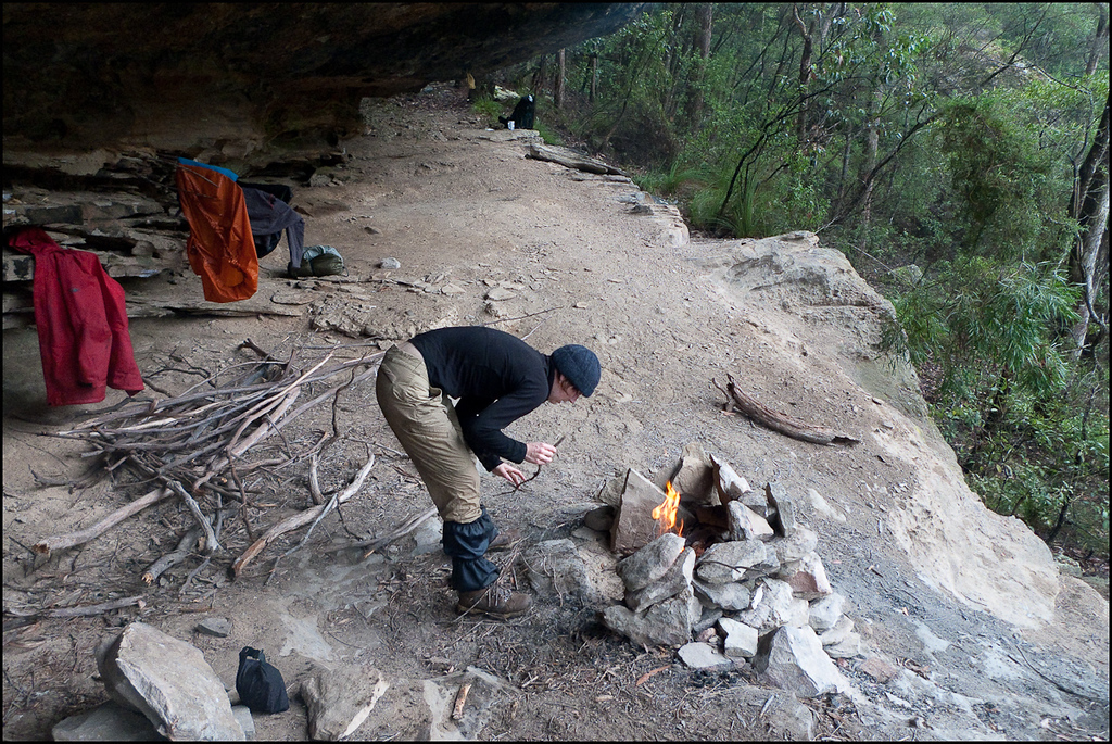 Cave woman discovers fire.