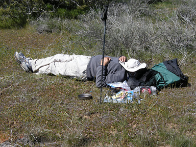 Lunchtime! Sam's interpretation of lunch was to take a nap…  By now we had discovered why Sam's pack seemed to have so much room: he had forgotten his sleeping quilt! We decided to just make our excursion a day-hike; the original plan had been that Tom and Karen would hike along with us for a ways and then turn back, while Sam, Sheila, and I would camp out overnight. The forecast was for below-freezing temperatures overnight, so not having some way to keep warm overnight would have been unpleasant. Ultimately, our change in plans allowed all of us to stay together and enjoy each other's company more fully.