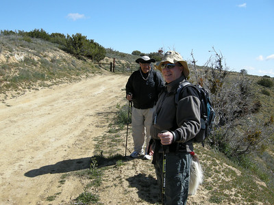 At the trailhead: Tom Armstrong, foreground, and Sam Duran, with Sheila showing only her tail and her shadow.
