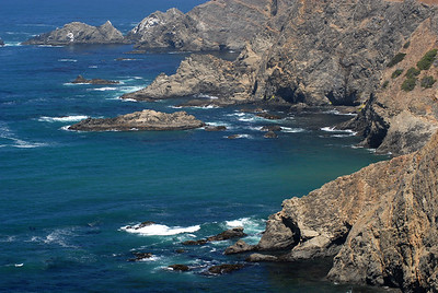 © Joseph Dougherty.  All rights reserved.   California coast with calm seas against rough rocky cliffs.