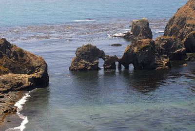 © Joseph Dougherty.  All rights reserved.   California coast with offshore rocks containing caves and natural sea arches.