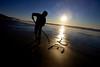 Cory Burnett writes love in the sands of Cannon Beach.