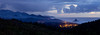The fog raises in the hills around Cannon Beach on a quite blue evening. Cannon Beach Panorama.