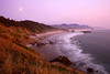 The moon rises through the evening pink glow at Ecola State Park. Many say it is the best view on the Oregon Coast.