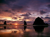 Sunset at Haystack Rock in Cannon Beach, Oregon. Of all Cannon Beach photos, Haystack Rock is one of the most pictured scenes on the Oregon Coast. Photographers flock to Cannon Beach for sunset and the beautiful coastal landscape of Oregon beaches.