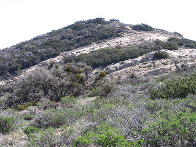 Approaching the rounded top of Caliente Peak, with its WWII-era lookout on top.