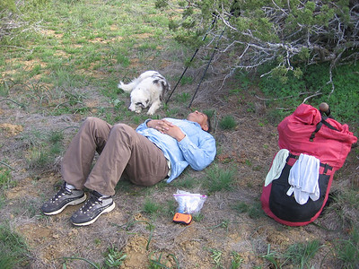 Master and dog, tuckered out. Is this far enough for today? SPOT satellite locator beacon (orange device) and my Golite Gust are also seen.