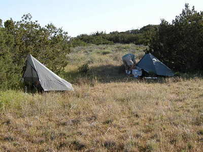 Our two Lunar Solo shelters set up with back ends towards the prevailing wind. These shelters use a walking stick to support them, and weigh just over 1.5 pounds each.