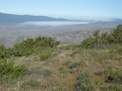 As we hiked along, the tongue of fog in the valley below retracted towards its source.