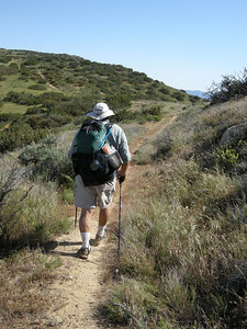 Hiking along the trail. After our encounter with the rattlesnake, we were both using our walking sticks to poke at trailside bushes a bit more than before!