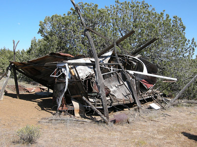 Chateau de Trashdump! An old trailer, probably used by cowboys or sheepherders, collapsing.