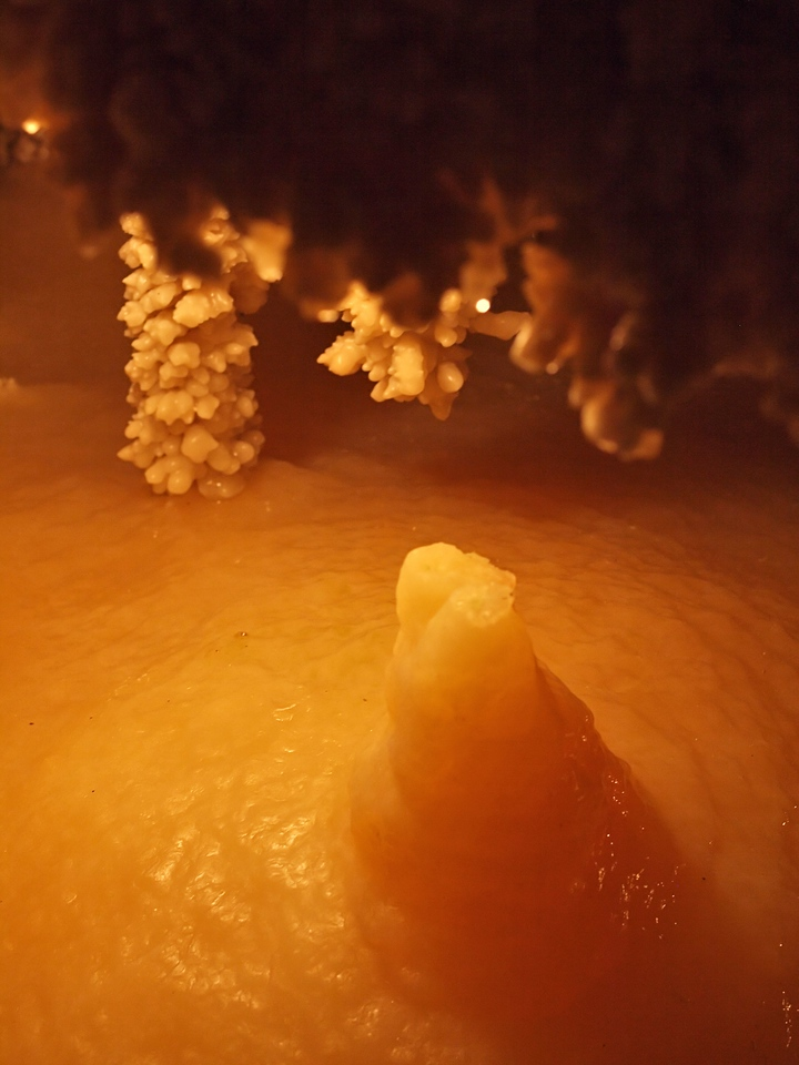 Applesauce lake with stalagmite.