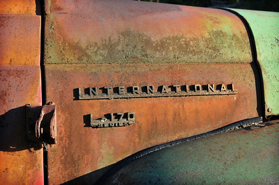 Rusted, but not rusted through. This is from an era when trucks were heavy metal.