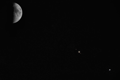Moon, Jupiter, and Venus close together in the sky