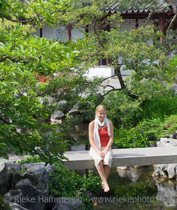 Young Woman on Bridge in Chinese Garden - Dr. Sun Yat-Sen Classical Chinese Garden, Vancouver, British Columbia, Canada