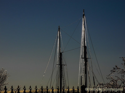 Appledore masts sparkle in the setting sun on Christmas Eve in downtown Bay City.