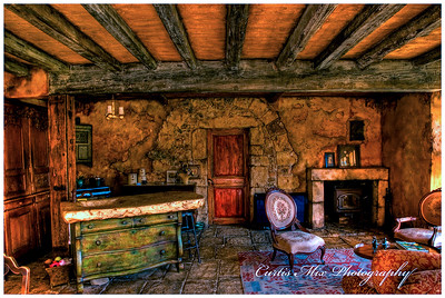 The kitchen and fireplace.
