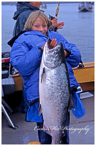 Kelli caught this salmon herself when she was eleven. We really need to go there again! This is at the mouth of the Rogue River at Gold Beach, Oregon.