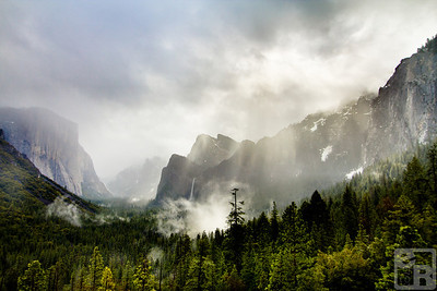 The suns rays cause mist to rise from the valley floor