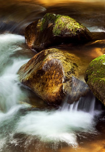 A small cascade flowing over the rocks.  Jones Gap State Park, near Greenville, SC.