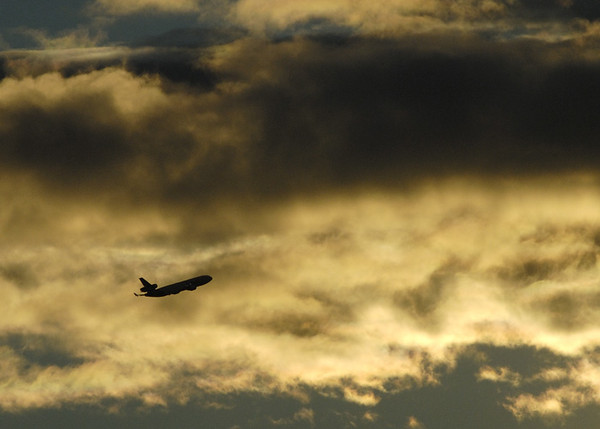 This jet was taking off from Ted Stevens International Airport in Anchorage. I photographed this from the Tony Knowles trail just a couple of blocks from downtown Anchorage in mid-September.