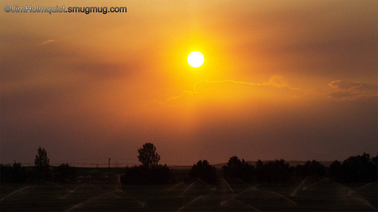 Sunset - Smoke from nearby fires adding color to the under exposed sunset near Idaho Falls, Id